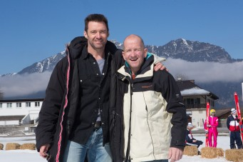 Hugh Jackman, left, poses with Eddie Edwards on the set of EDDIE THE EAGLE.