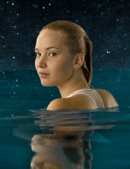 Aurora (Jennifer Lawrence) swims...a lot.